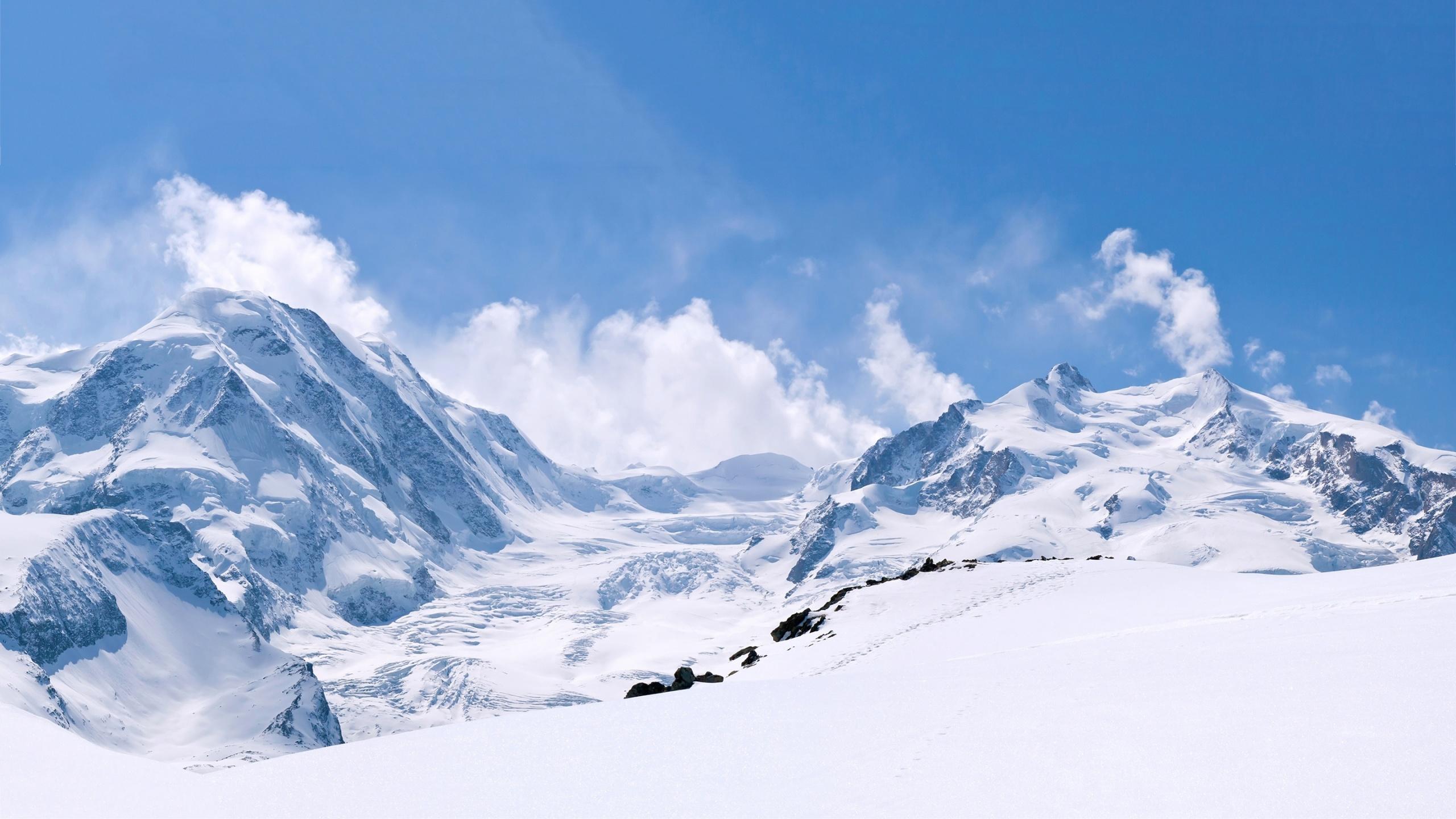 mountain wallpapers free,mountainous landforms,mountain,mountain range,snow,sky